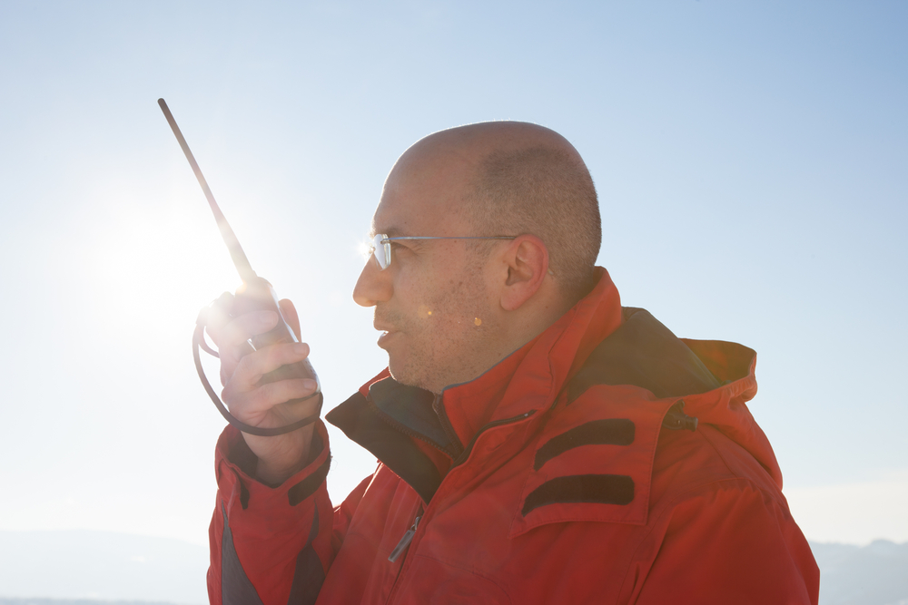 How does a PTT satellite phone work?